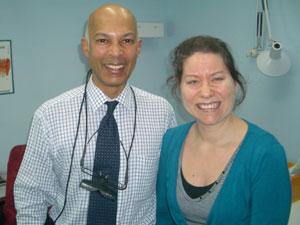 With Professor Da Cruz, after he checked my head. No scar at all just 13 days after cochlear implant surgery - I am just amazed. I am one happy customer.